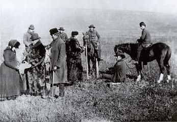 Alice Fletcher is on the left, working with the surveyors to assign allotments to individual Nez Perce Tribal Members.