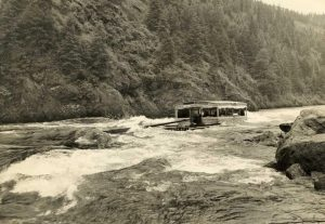 One section of the wannigan on its way down the North Fork of the Clearwater River. The wannigans followed the log drive crew to supply them with food and sleeping quarters during the drive which took 2 to 3 weeks.